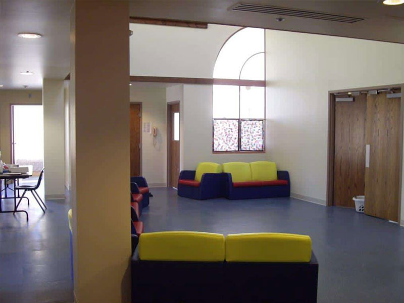 Colorful couches in a large, open room at Southwood Hospital