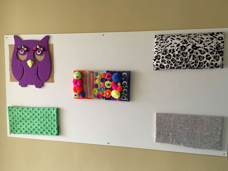 Crafts and art projects on a wall at Southwood Hospital